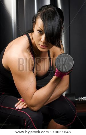Asian woman lifting weights