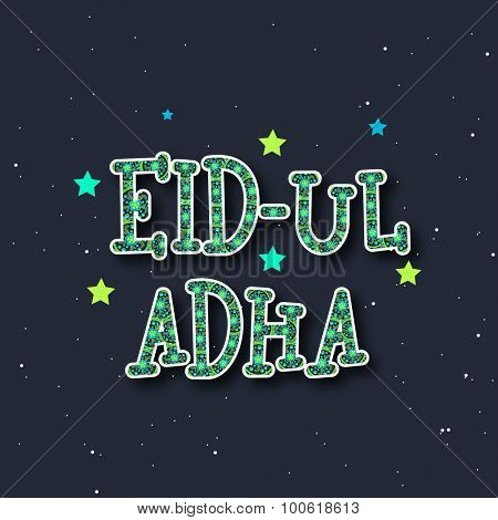 Creative artistic text Eid-Ul-Adha on stars decorated background, can be used as greeting or invitation card design for Islamic Festival of Sacrifice celebration.