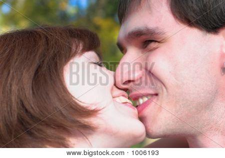 Kissing Couple In The Forest