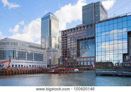 LONDON, UK - MARCH 31, 2015: Canary Wharf building site with cranes and digger. New resident skyscra