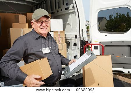 Elderly delivery man with parcel. Shipping service.
