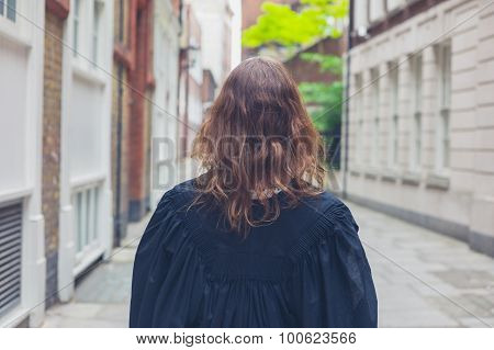 Young Woman In Graduation Gown