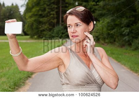 Woman In Gown Taking Self Portrait With Cell Phone