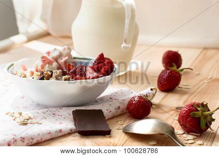 Granola With Strawberries, Yogurt And Strawberry Topping, Milk Jug And Strawberries