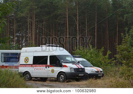 KIEV, UKRAINE - September 03, 2015: Ukrainian rescue and fireman team in the forest. A lot of fire forest near Kiev at beginning of September.