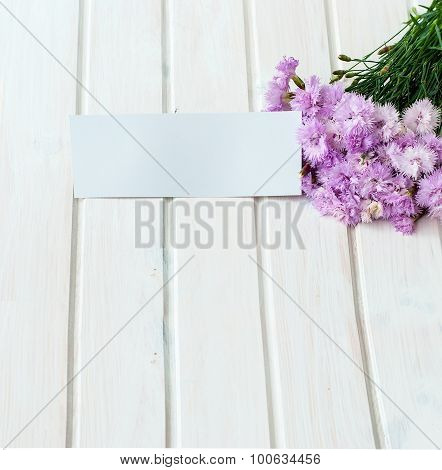 Bouquet Of Cornflowers On A White Wooden Background