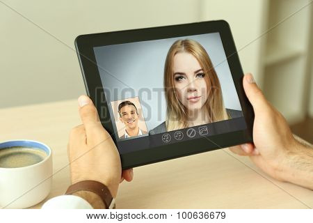 Young couple talking to each other via online video chat.