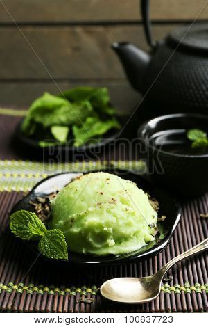 Homemade Green tea ice-cream on bamboo mat, on wooden background