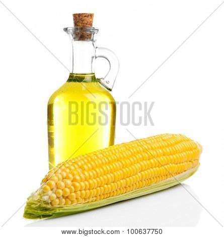 Fresh corn with bottle of oil isolated on white