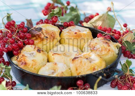 Appetizing baked apples with fresh Kalina