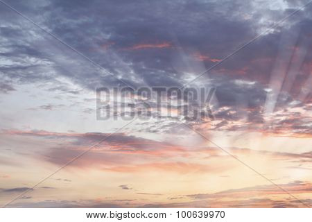 Sunlit clouds in summer sky