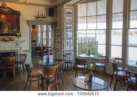 LONDON, UK - APRIL 14, 2015: Old English victorian public house interior. Early morning settings wit