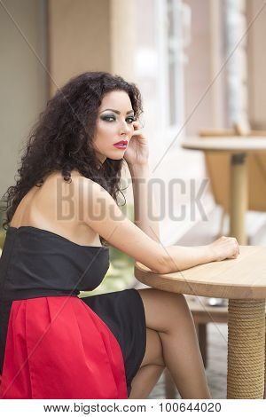 Attractive Sensual Young Woman Sitting At Table