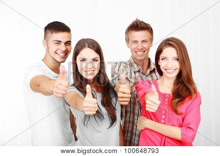 Group of happy young people, indoors