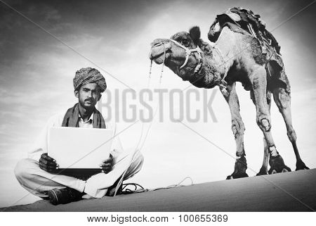 Indian Man Using Laptop Desert Concept