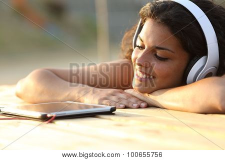 Woman Listening To Music From A Tablet