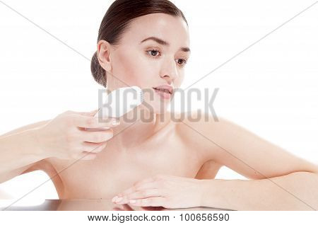 Woman With Brush For Deep Cleansing Facial. Skin Care Concept. High Technology Beauty.