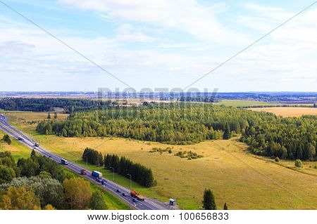 highway through the fields and forests
