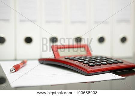 Concept Of Accountant Desk With Calculator,pen,document And Documentation In Background