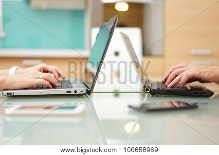 Woman And Man At Home Typing On Laptop Computer