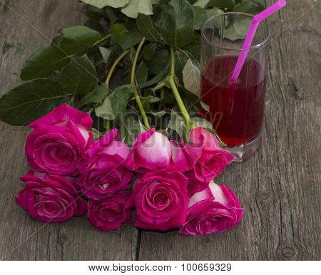 Bouquet Of Red Roses And Glass Of Juice With A Tubule