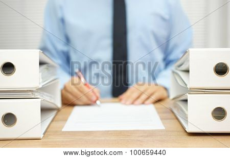 Businessman Is Writing Report About .irregularities In Company Data