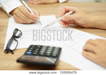Businesswoman Is Explaining Terms And Conditions In Agreement To His Client Before He Sign The Docum