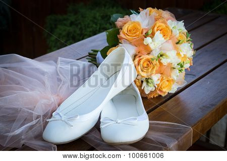 Bridal Bouquet And Bride's Shoes