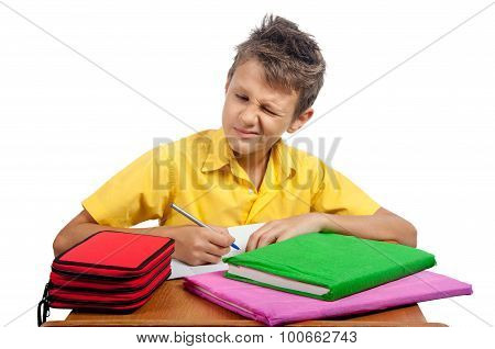 Boy With Book Makes A Grimace. All On White Background.