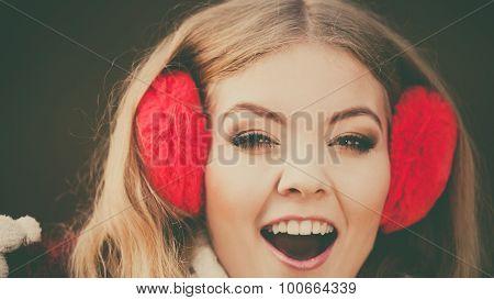 Portrait Of Pretty Smiling Woman In Red Earmuffs.