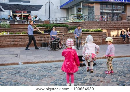 HRODNA BELARUS - JUNE 27 2015: Street musicians play on The Annual International Big-Mini-Festival of Street and Area Art June 27, 2015 in Hrodna, Belarus.