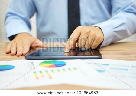 Stock Broker Is Researching Stock Market On Computer Tablet