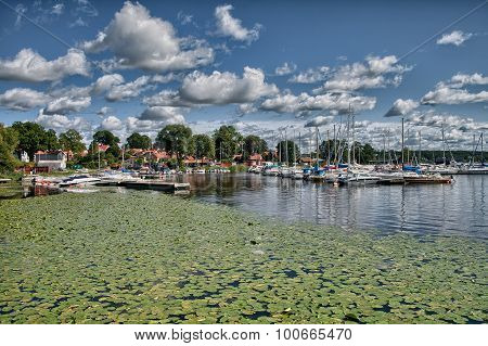 Puffy clouds blue sky above a town on Malaren lake Sweden