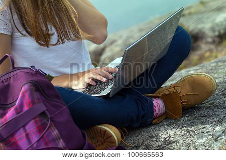 Girl Hiker With A Laptop