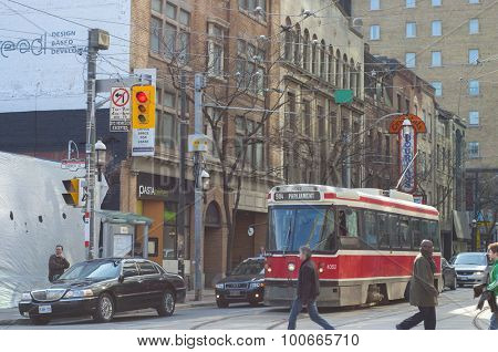 TORONTO,CANADA-March 15,2012: A view of downtown Toronto with the 501, an east-west 24km  streetcar route operated by the Toronto Transit Commission (TTC), the longest  in North America.