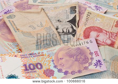 Us Dollar And Argentine Peso Bills