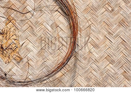 Close Up Iron Wire And Old Woven Flat Mat  Bamboo Grass