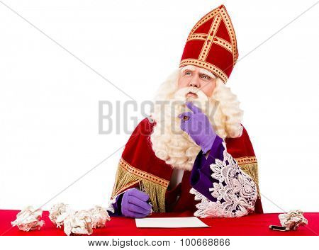Sinterklaas thinking of what he should write