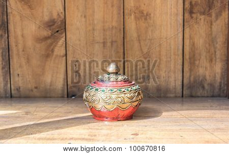 Thai Casket Wood Craft  On The Wooden Background Against The Light With Shadow