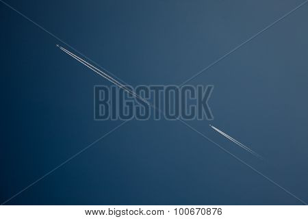 Airline contrails. Airplanes flying agains blue sky