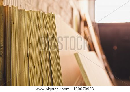 Ply Wood In Workshhop. Warehouse Decoration. Stack Of Chipboard In A Warehouse