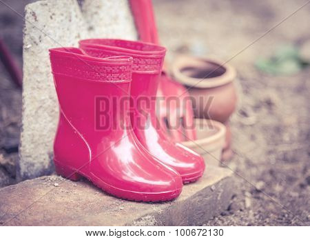 Red Color Baby Boots. Garden Boots For Children , Vintage Color Tone