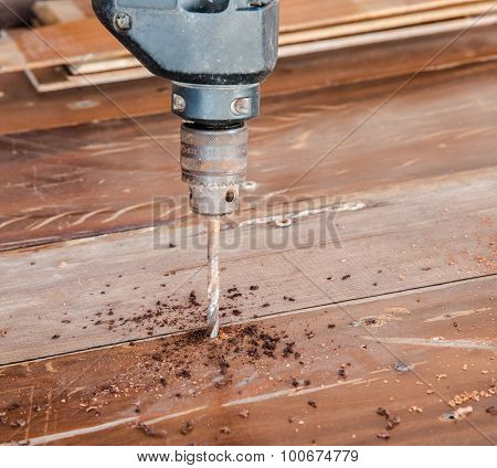 Closeup Wood Board Drill By Electric Hand Drill