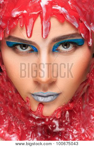 portrait of a beautiful girl bathed in red wax