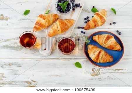 Fresh Croissants And Tea With Berries For Breakfast.