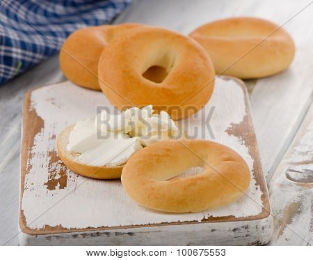 Bagels With Cream Cheese On A Wooden Board.