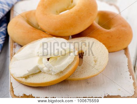 Bagels With Cream Cheese On  Wooden Board.