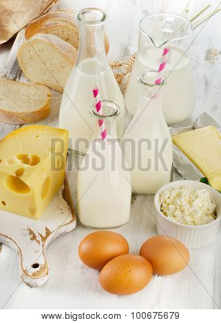 Dairy Products, Bread  On A White Wooden Table.