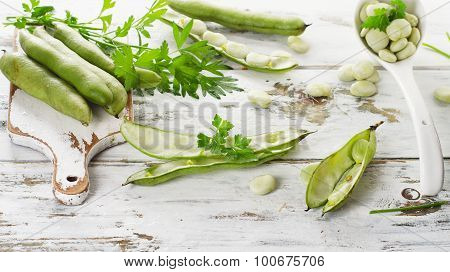 Broad Beans On A Wooden Table.