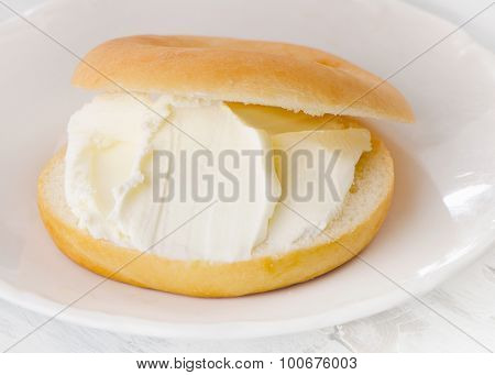 Plate With Sliced Bagel And Cream Cheese.